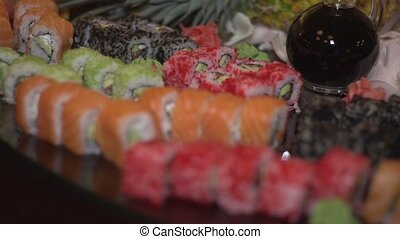 Snack sushi - Tobiko sushi with wasabi, soy sauce and flying...