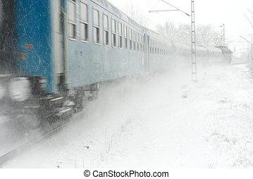 Train passing by with motion blur in a snow storm
