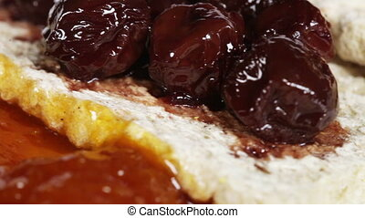 Crispbread with jam - Rotating on white plate bread with...
