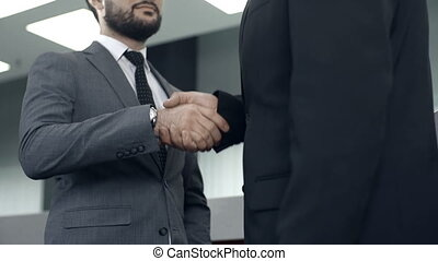 Business Proceedings - Tilt up of two businessmen...