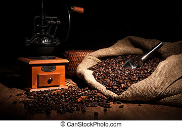 coffee still life on a wood - coffee beans, coffee mill, bag...
