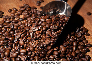 roasted coffee beans with scoop