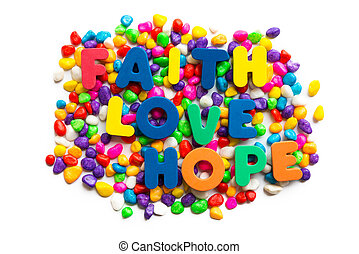 faith love hope words on the colorful stone and white...