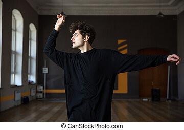 Portraito f a handsome young man dancing at gym
