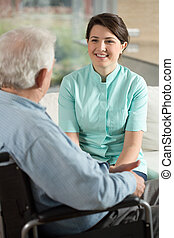 Nurse working at retirement home - Image of nurse working at...