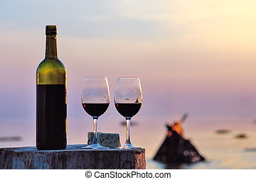 Wine glasses  - Red wine bottle and wine glasses at the sea