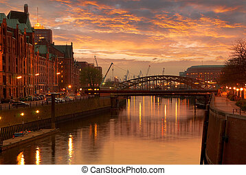 Hamburg Speicherstadt brick buildings in orange evening...