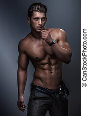 Muscular body. - Strong muscular handsome man posing in...
