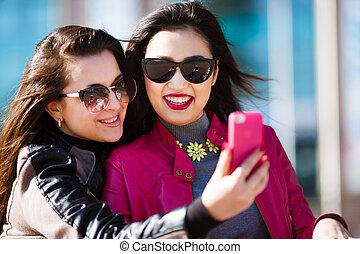 Two happy women making selfie photo - Two happy beautiful...