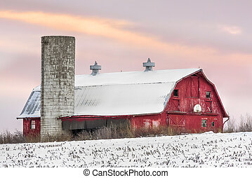 Winter Barn at Sundown - A snowy red barn with silo and...