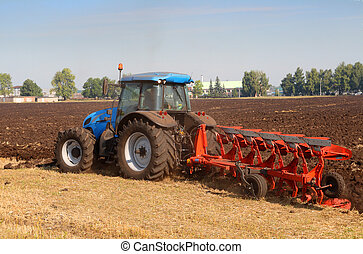tractor with plough - agriculture tractor with plough in...