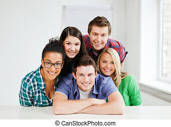 group of students at school - education concept - group of...