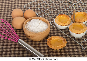 Baked egg tart on tray