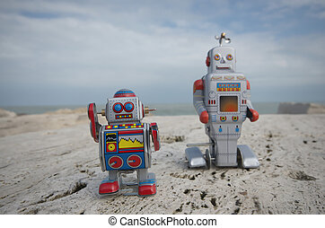 Tin toy robot buddies on the rocks - My best friends, two...