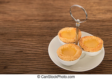Egg tart on wooden background