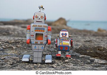 Two tin toy robots on the rocks - Childhood memory with two...