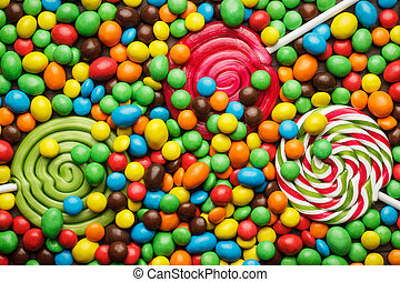 different colorful sweets and lollipops on the table