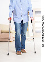 Man with crutches - Man walking with crutches,...