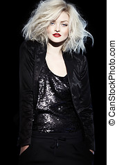 Chic Noir - Platinum blond woman in black outfit.