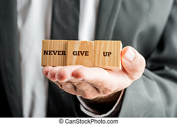 Never give up - Professional consultant holding up three...