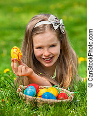 Child find easter egg outdoor. - Happy child with bow find...