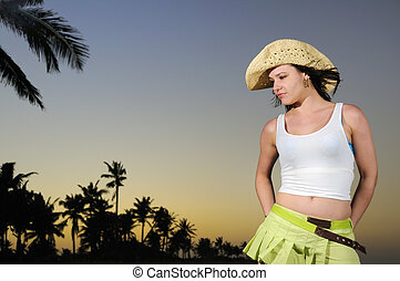 Tropical hispanic beauty on beach at sunset