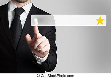 businessman pushing button golden star - businessman in suit...
