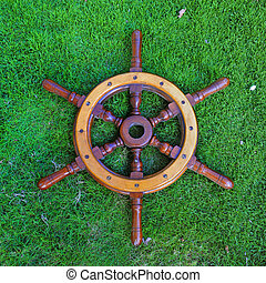 Wodden helmsman - Woodden helmsman over green grass...