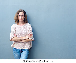Confident mid adult woman posing with arms crossed -...