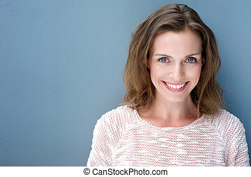 Beautiful older woman smiling with sweater - Close up...