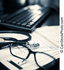 Medical concept - Stethoscope on a prescription form with...
