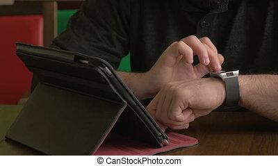Businessman working on smart watch