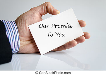 Our promise to you - Bussines man hand with text Our promise...