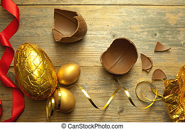 Chocolate easter egg - Gold easter egg with broken chocolate...