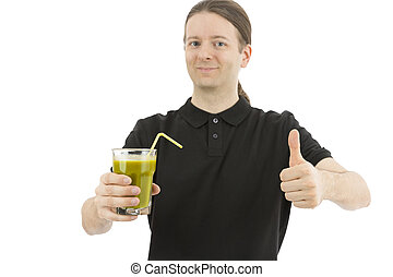 Man holding a glass of green smoothie and giving thumbs up -...