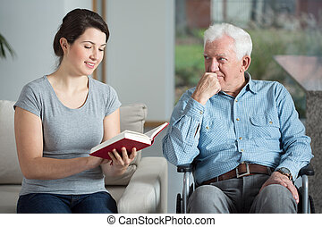Man spending time with granddaughter - Disabled man spending...