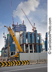 building site - cranes and scaffolding in an urban building...