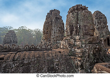 khmer ruins - carved stone towers in a khmer site