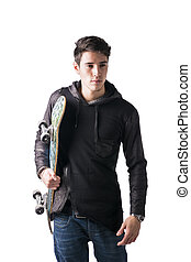 Handsome young man with skateboard under his arm - Handsome...