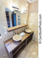 Marble basins - Contemporary marble round basins on wooden...