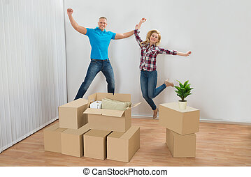 Excited Couple In New House