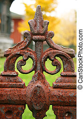 Close-up of an iron fence - Close-up of old intricate iron...