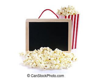 Isolated popcorn - Popcorn and blackboard on a wooden table