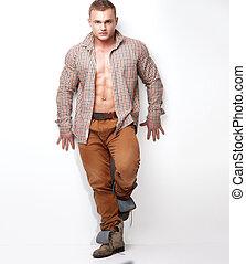 Fashionable muscular man.