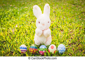 Sugar rabbit and easter eggs on meadow - Sugar rabbit and...