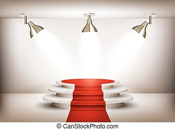 Showroom with red carpet leading to a podium and three...