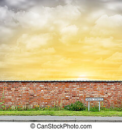 Brick Wall with a Main Street Sign and Sunset, Sunrise - A...