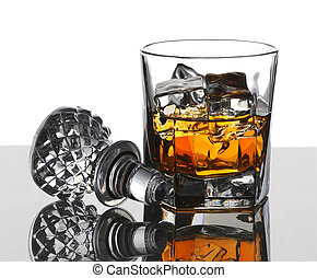Scotch and Decanter Top - Glass of scotch on the rocks with...