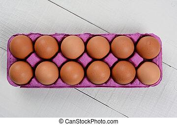 Dozen Brown Eggs - High angle shot of a dozen organic brown...