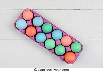 Pink Carton of Dyed Easter Eggs - A pink one dozen carton of...